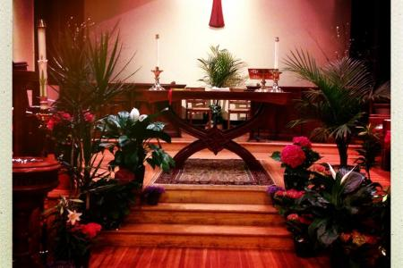 St. John's altar at Easter, with palms and flowers